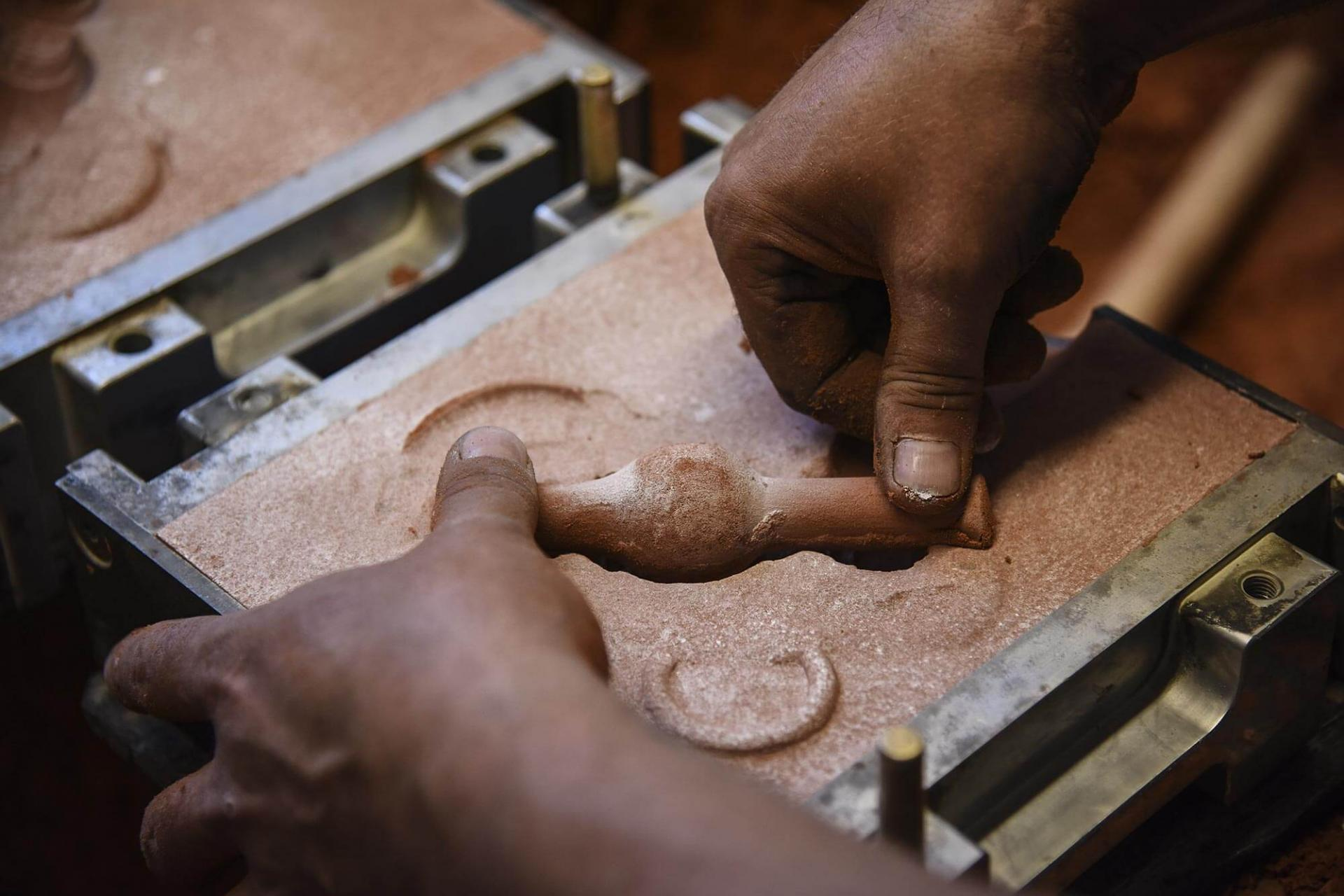 Sand casting and pouring