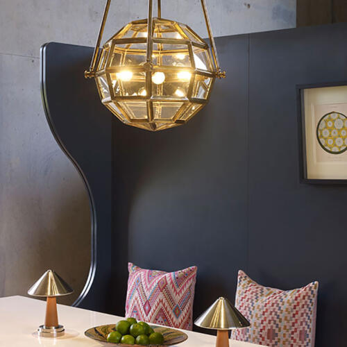 hanging brass globe light by Collier Webb