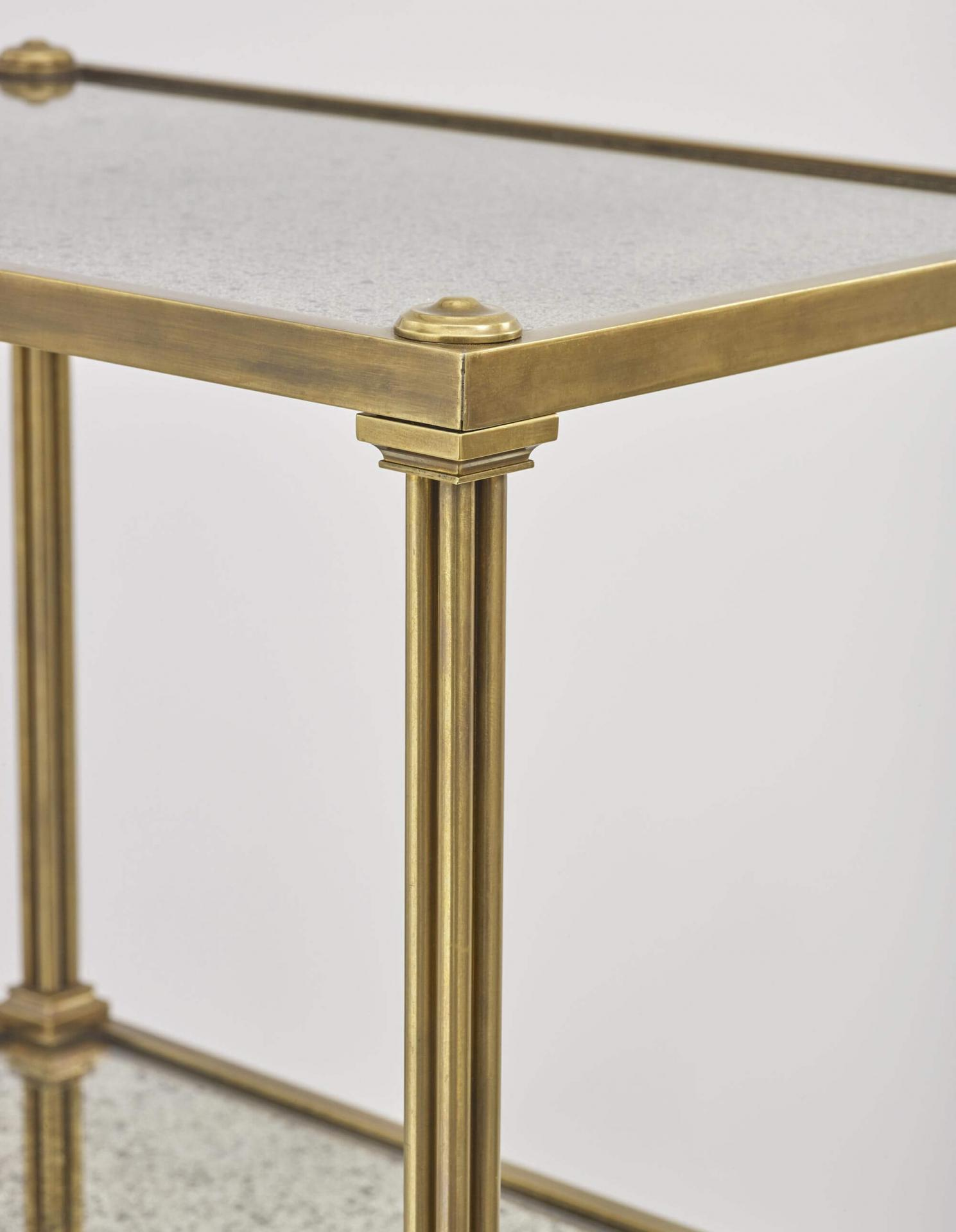 The Carolyn table by Collier Webb is a metal mirror plate side table