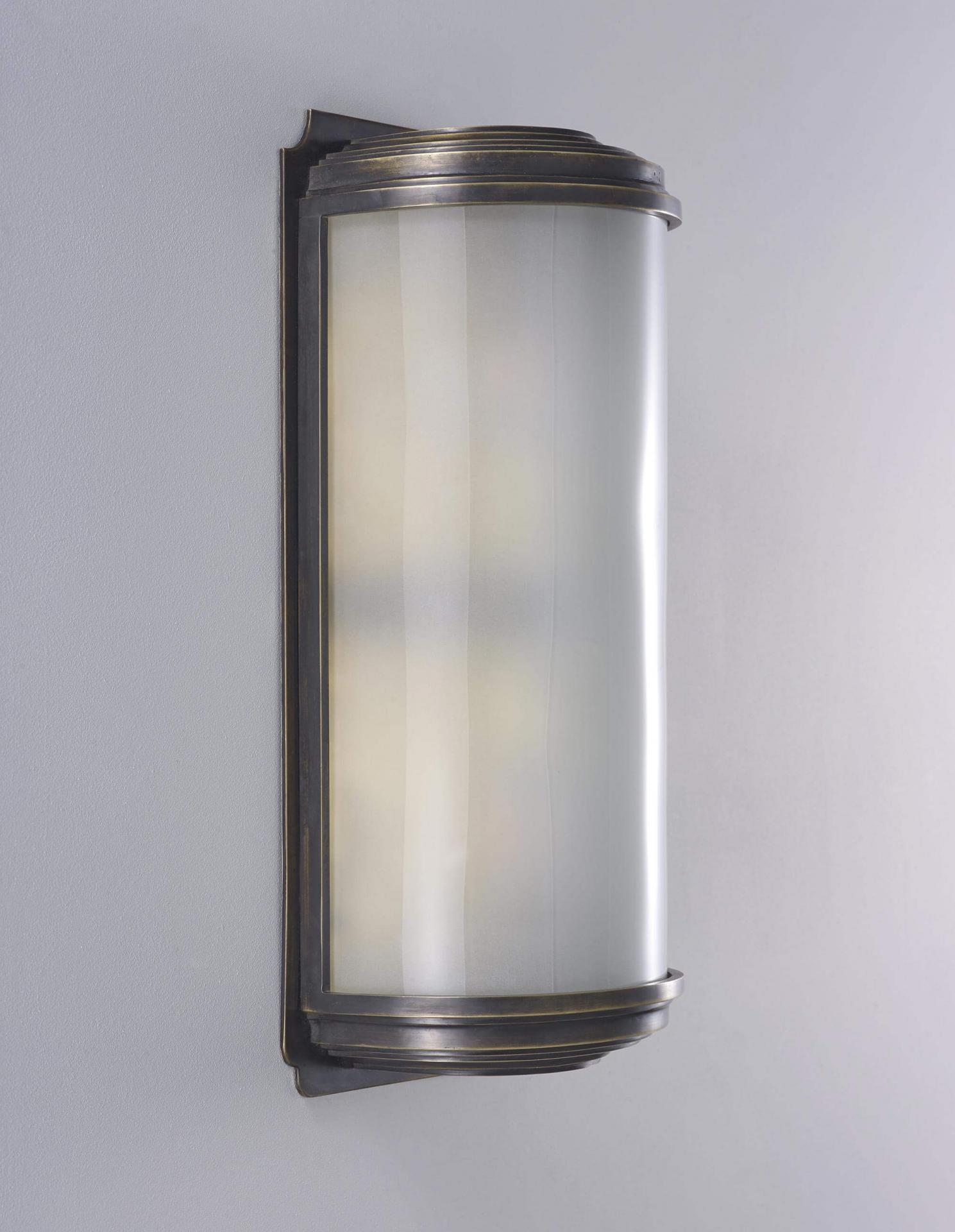 Cylinder wall light by Collier Webb - a brass and glass sconce ideal for an entrance hall
