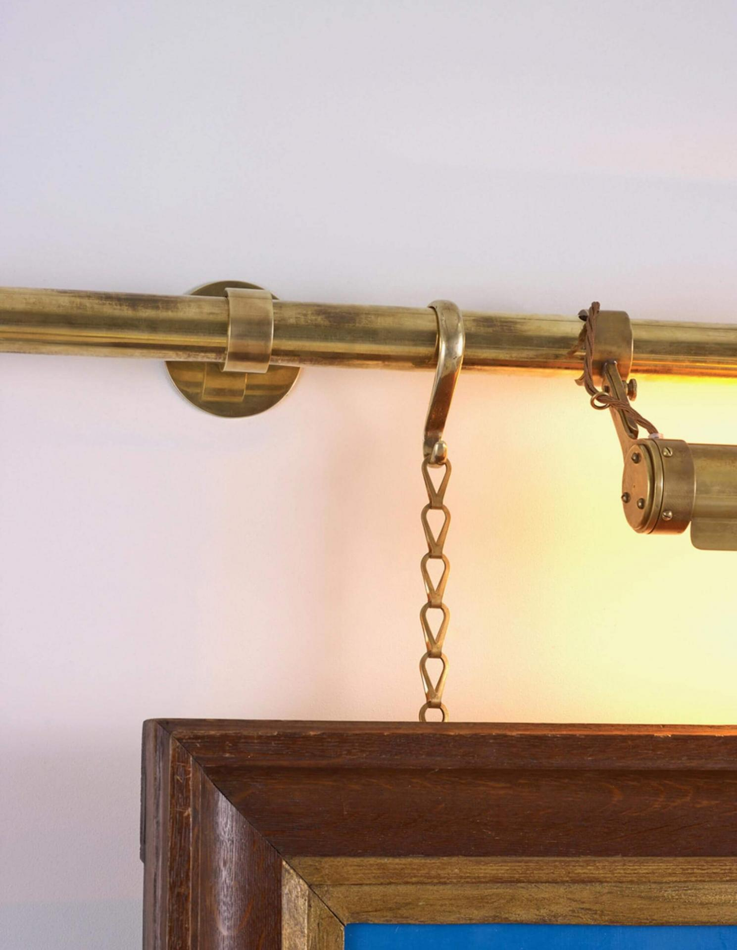brass picture rail and lighting for art hanging