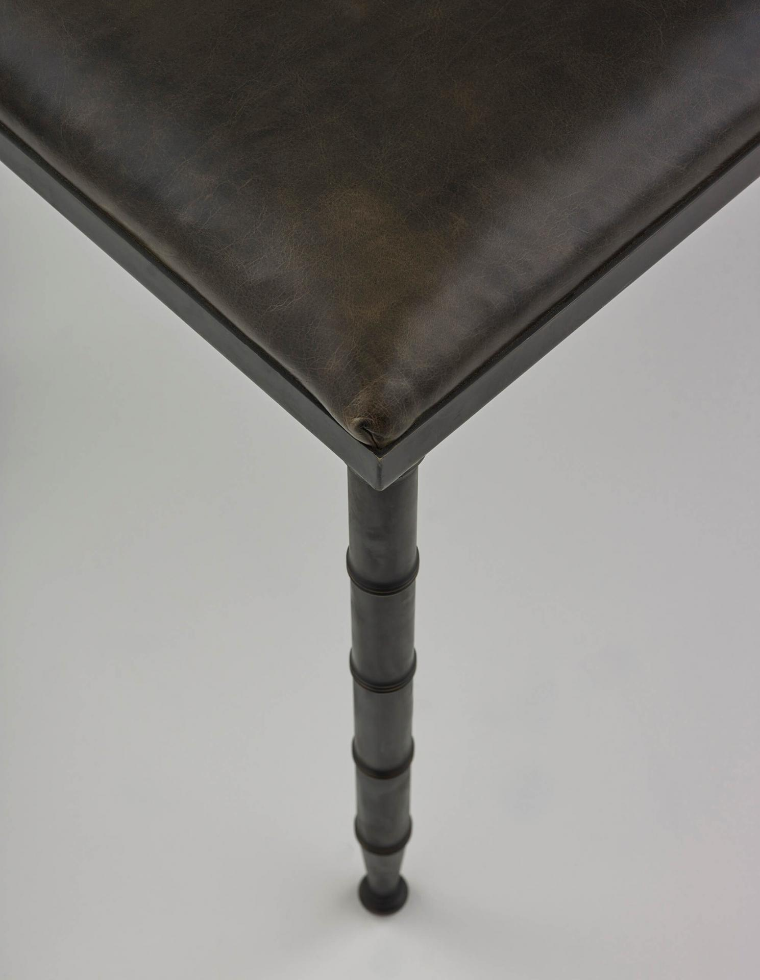 Ramsay Bench, a brass and leather bench