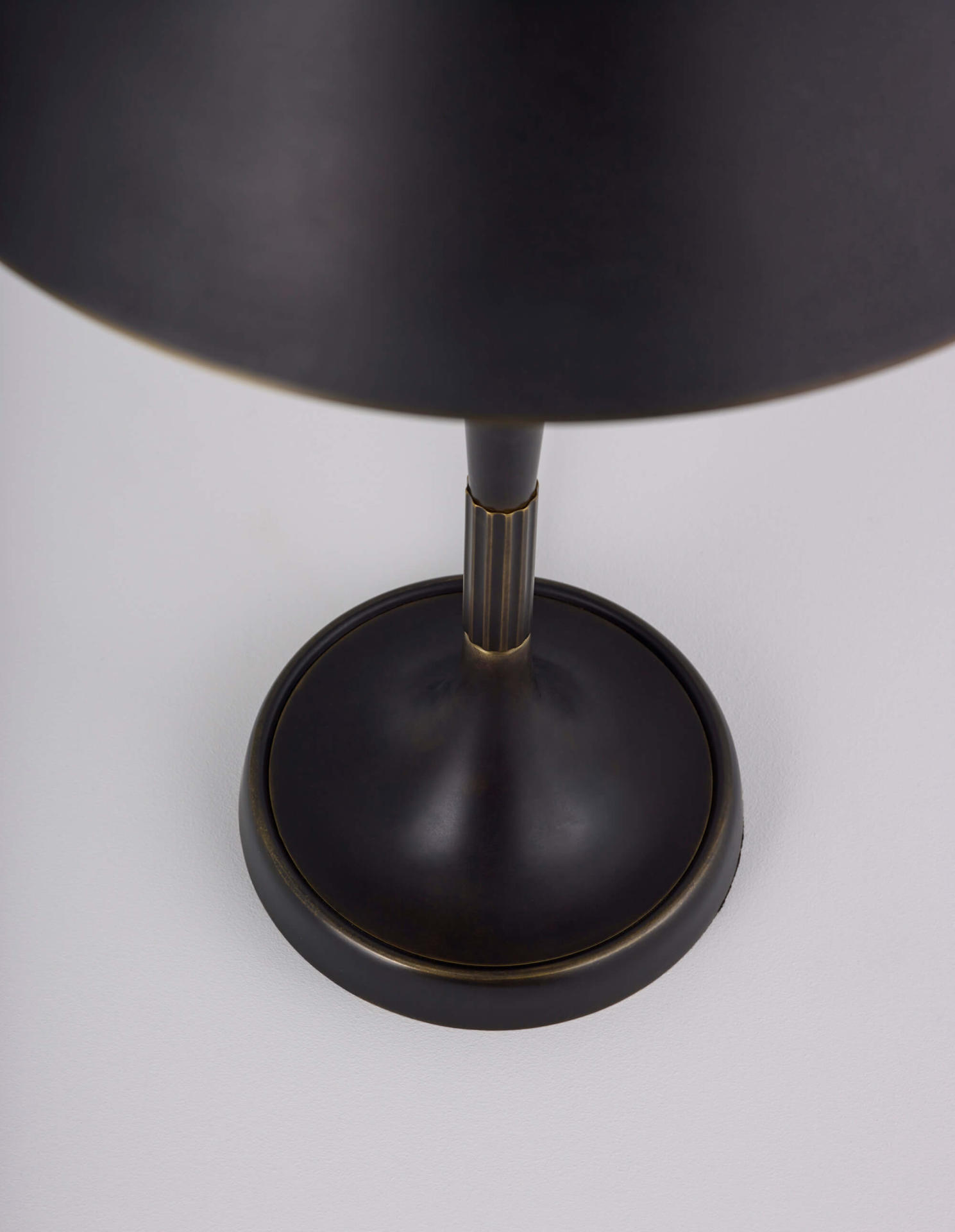 the brass shade of the Bourse table lamp