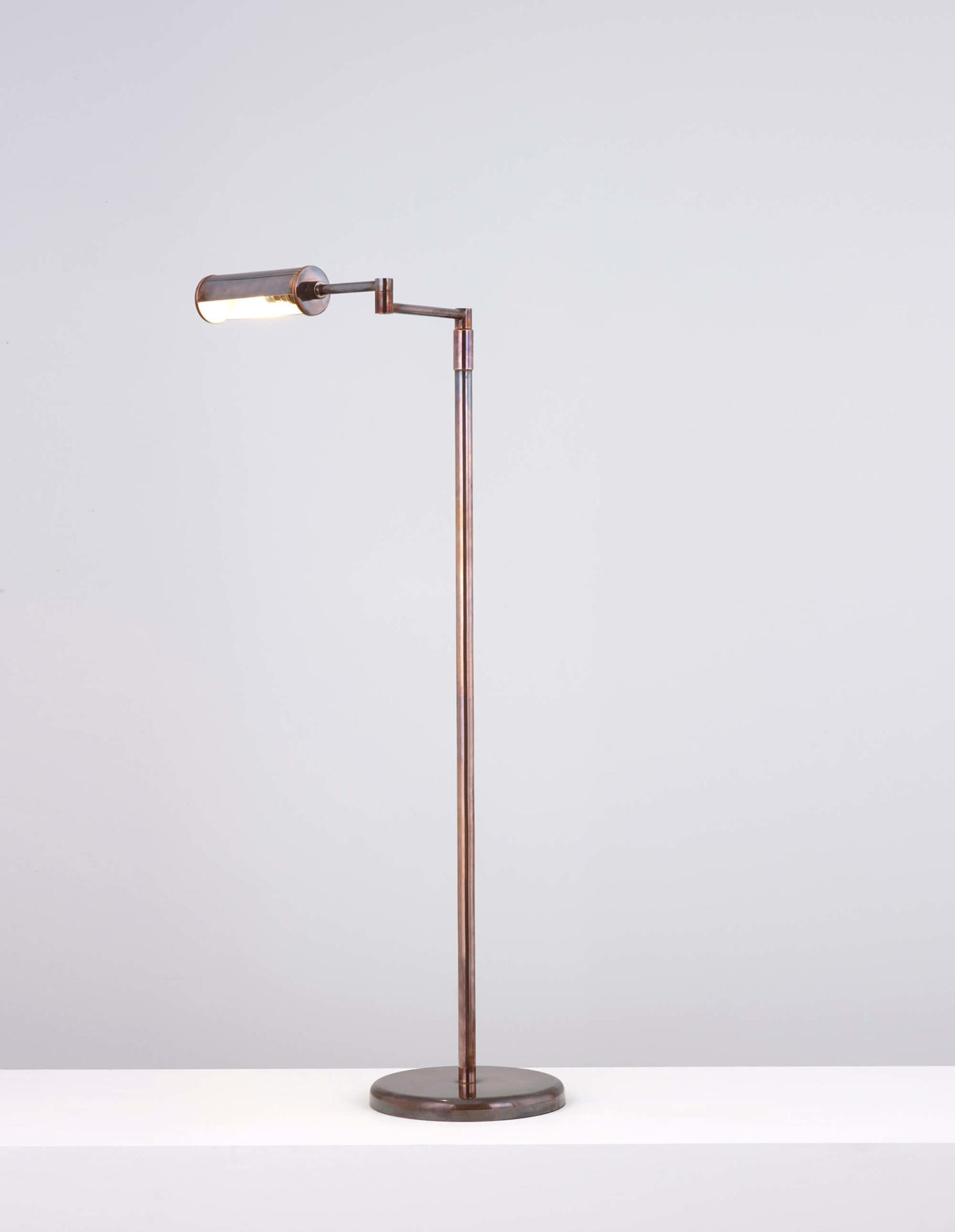 Cylinder floor lamp - an adjustable brass lamp ideal for use as a reading light