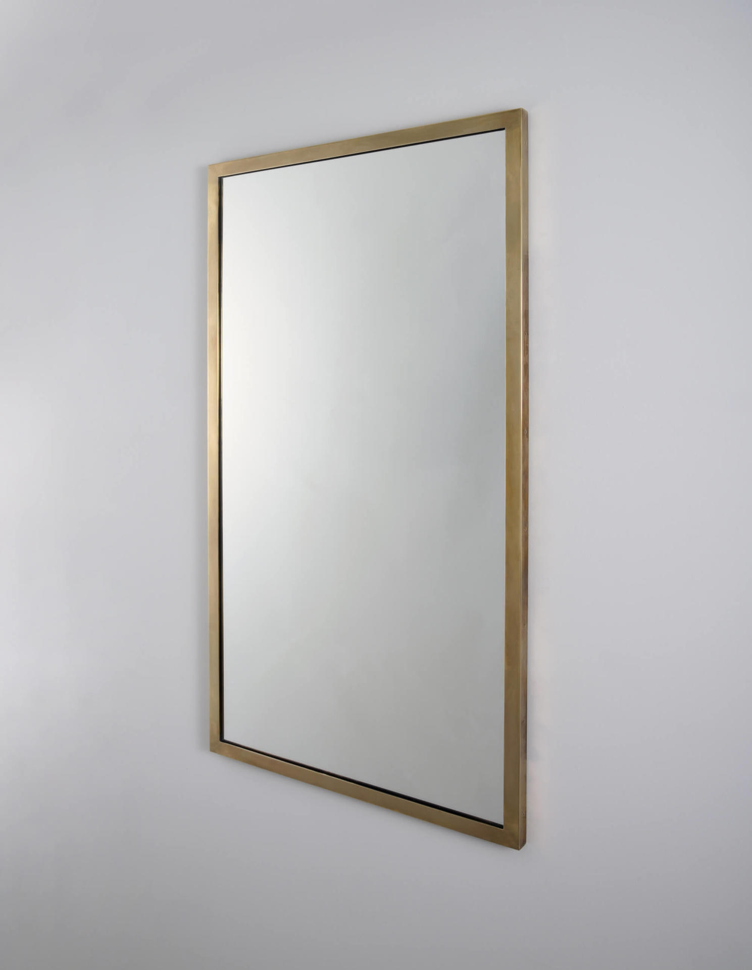 The Salon, a brass framed mirror by Collier Webb - ideal for interior design projects
