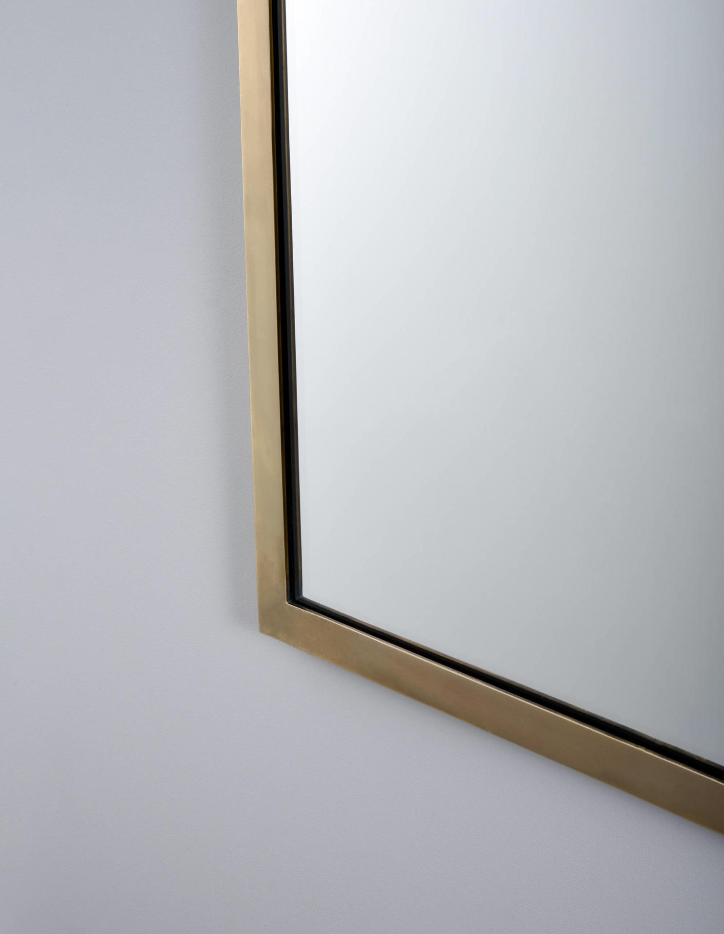 The Salon, a brass framed mirror by Collier Webb - ideal for interior design projects. Seen in our Antique Brass finish