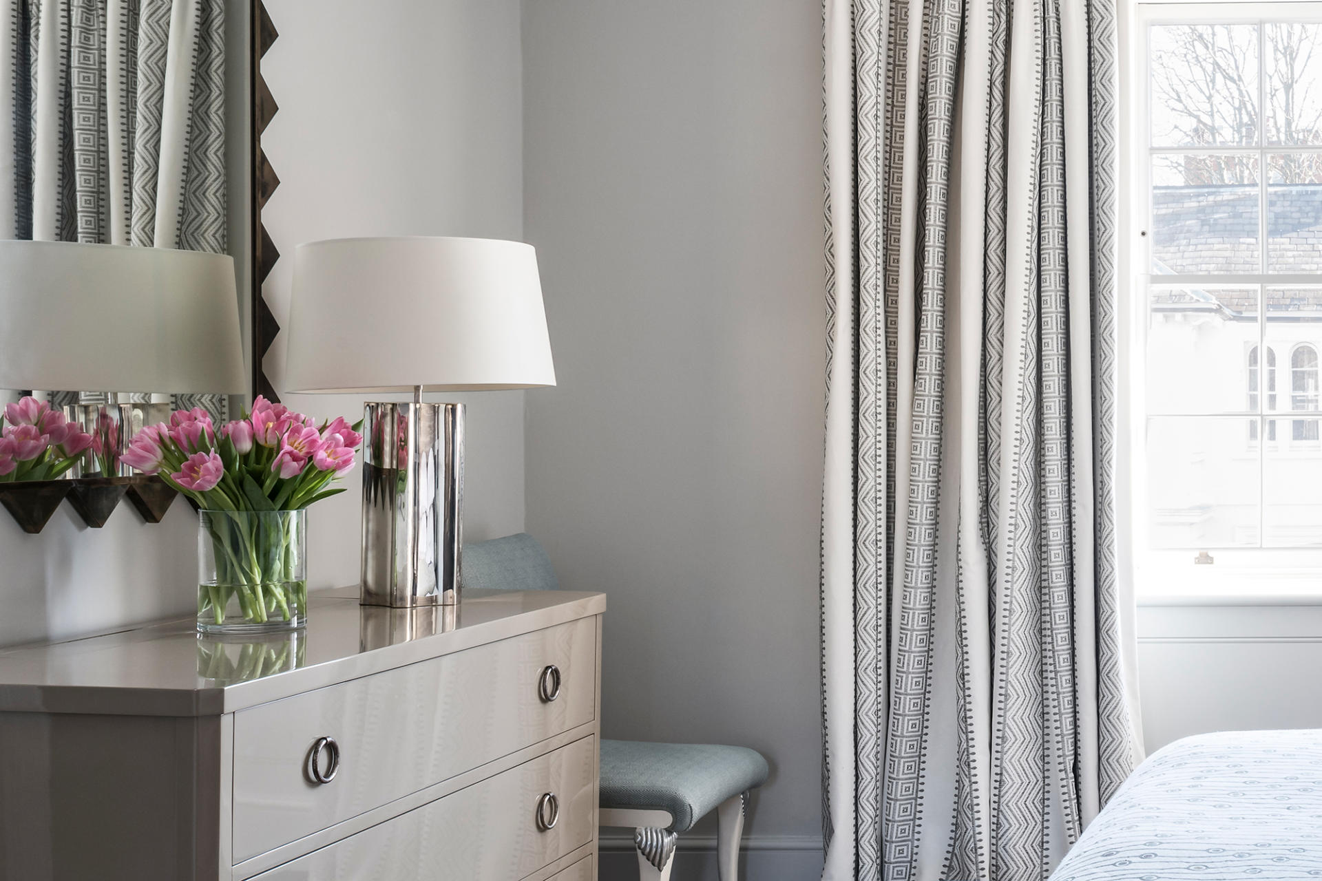 A beautiful bedroom design with a Collier Webb Baratta Lamp
