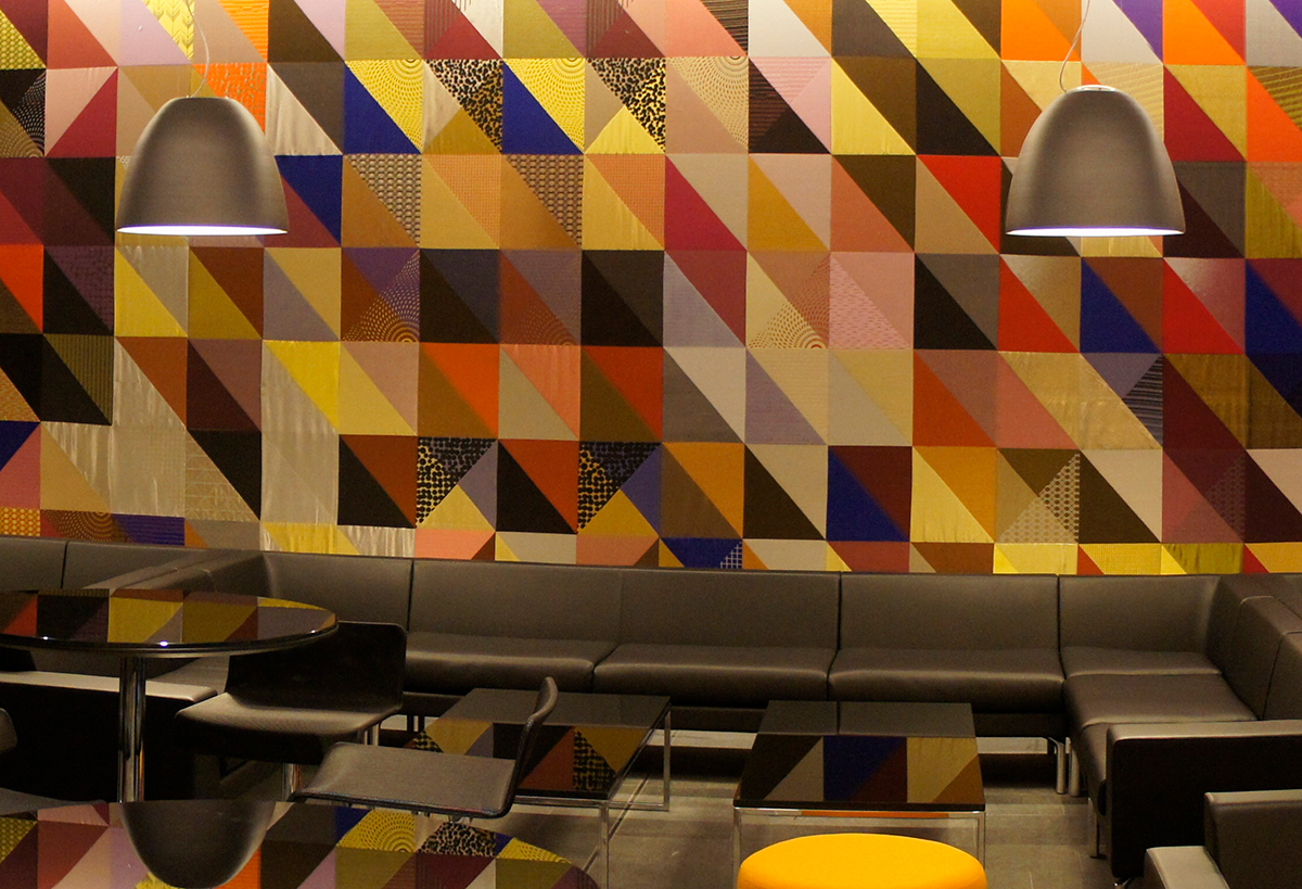 A contemporary woven wall covering at Oxford Brooks University – created by Gainsborough for design studio, Peagreen