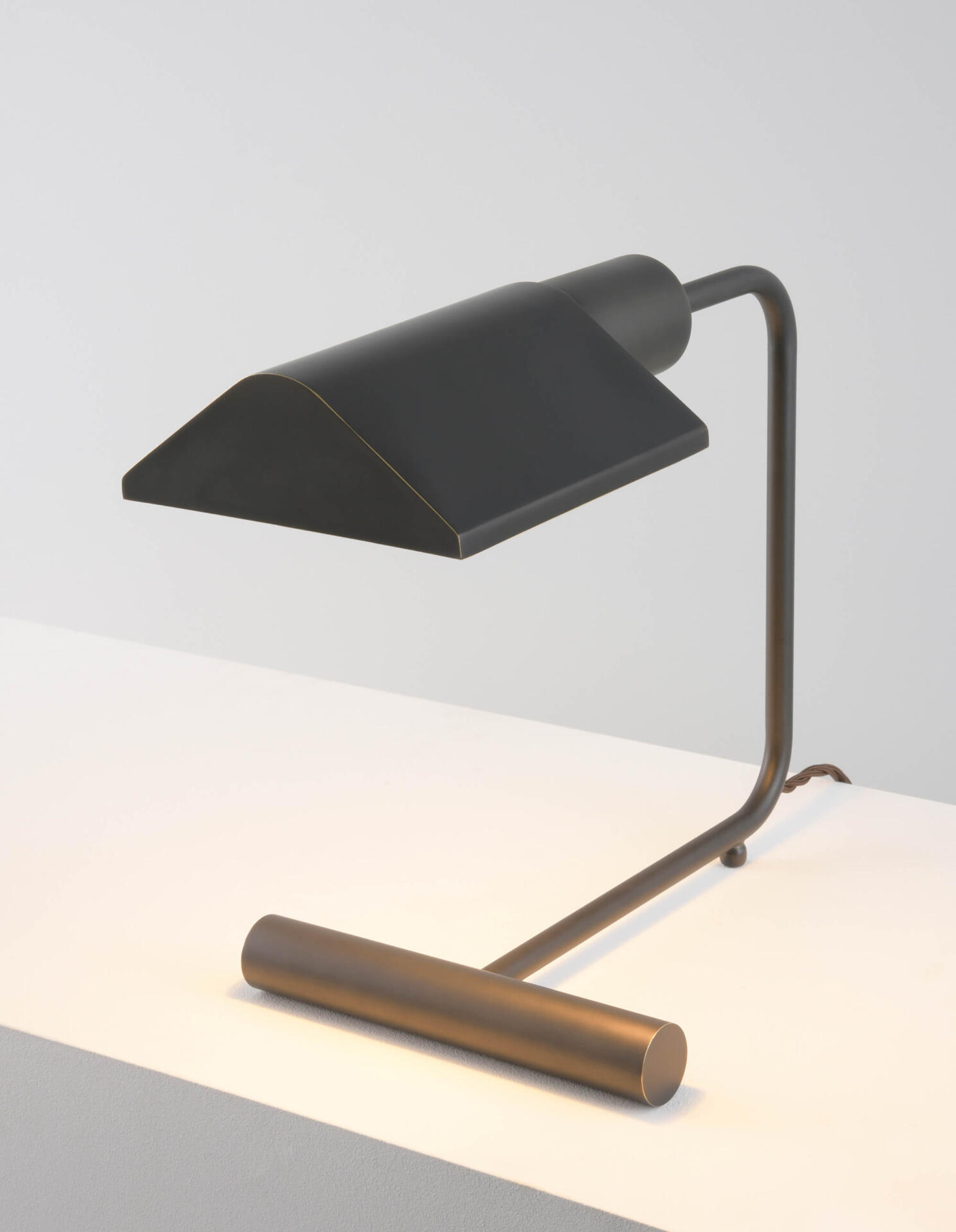 A mid century style desk lamp made from brass and coloured in an Antique Bronze finish