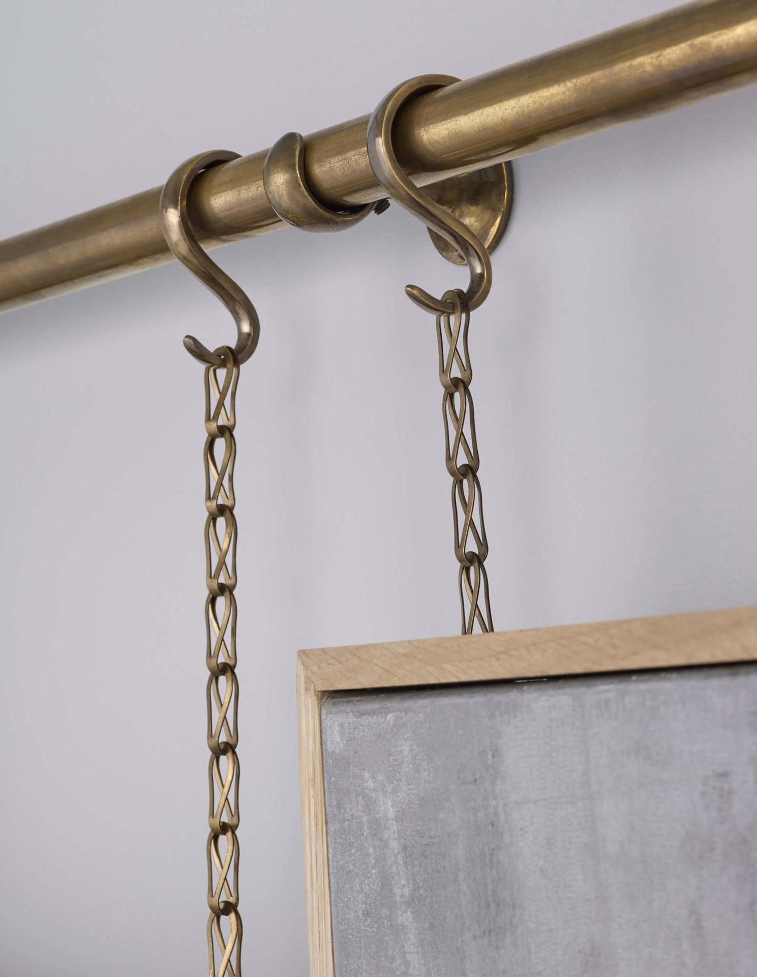 art hanging with brass picture rail and chain