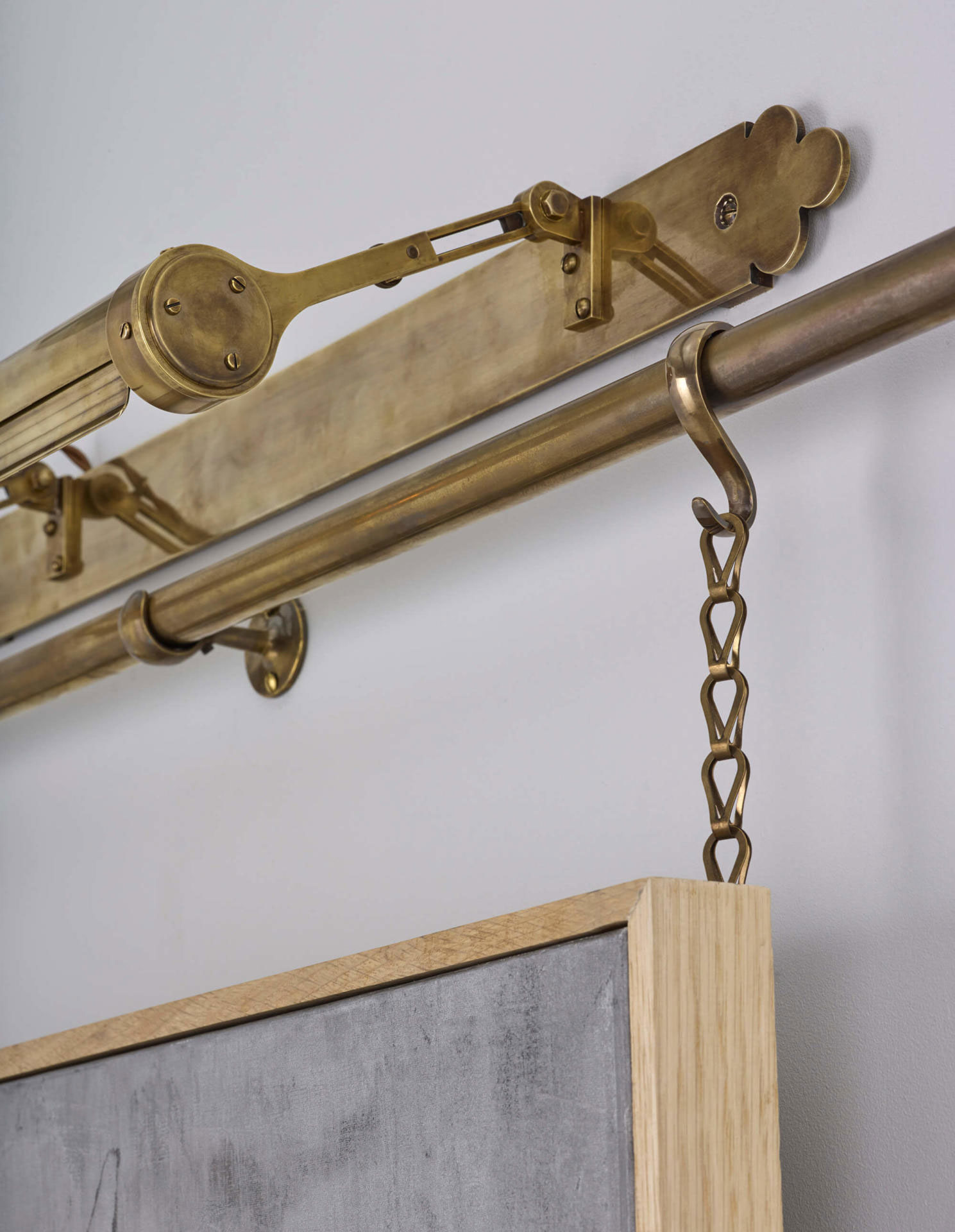 Brass picture rail and lighting
