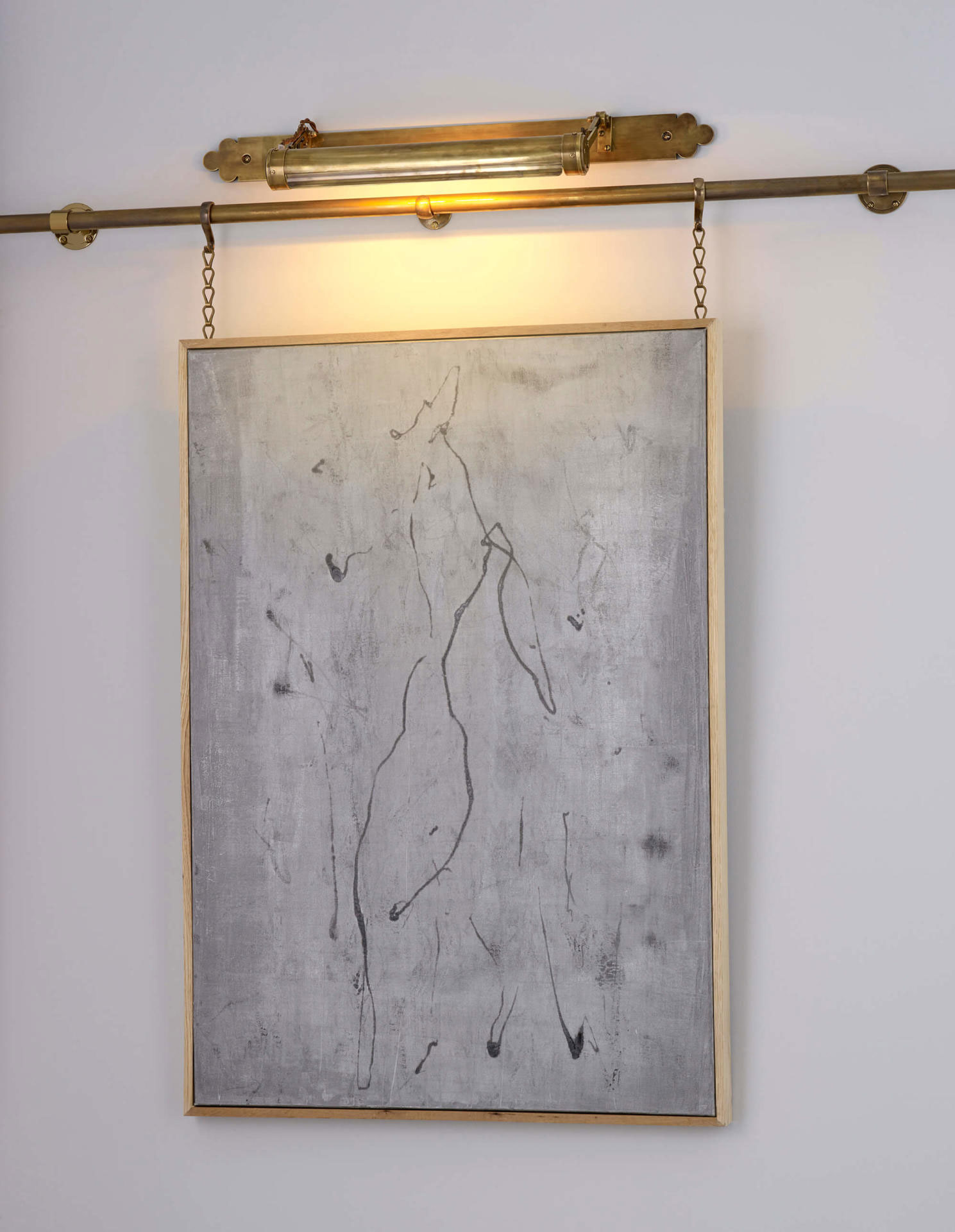 Art hanging with brass picture rail