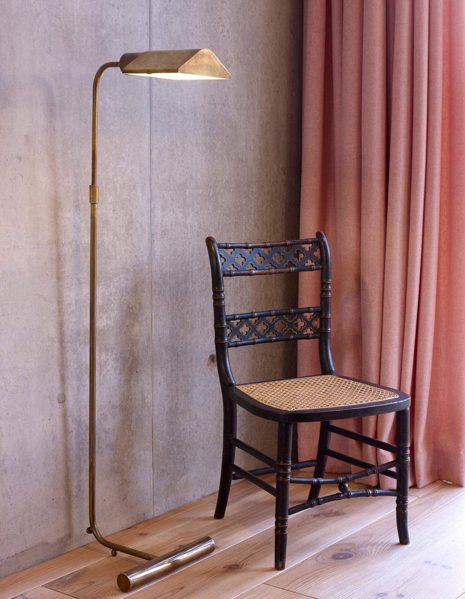 The Mallet Floor Light pictured in an Antique Brass finish