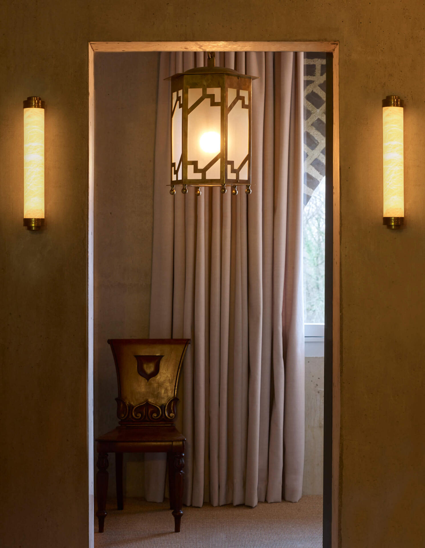A pair of alabaster wall lights by Collier Webb