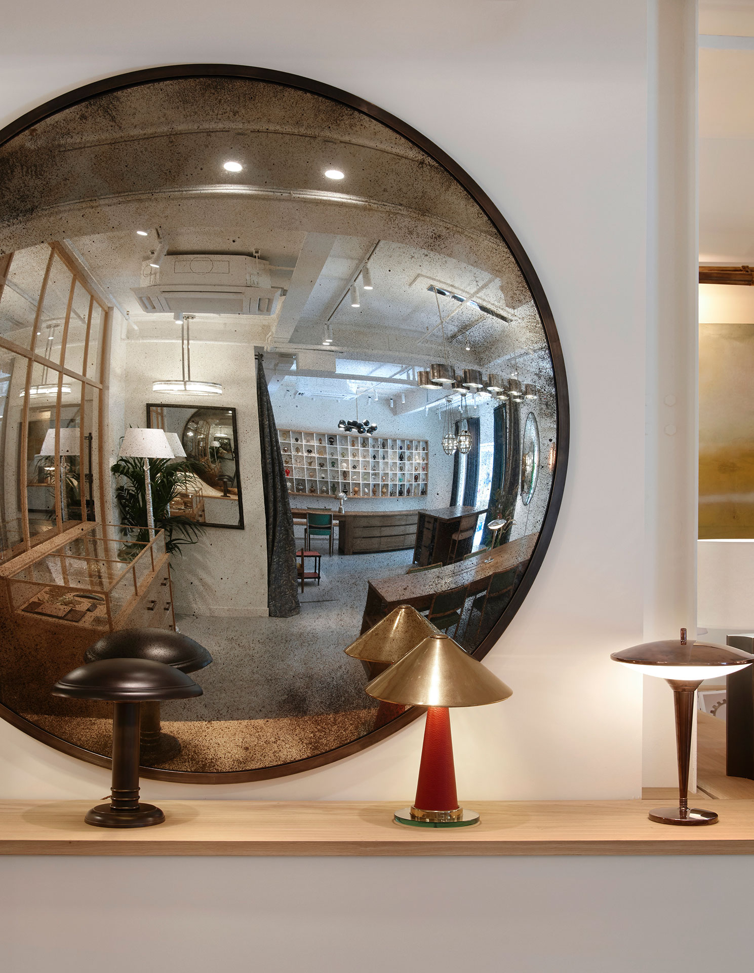 brass framed convex mirror with antiqued mirror plate at Collier Webb Design Centre Chelsea Harbour