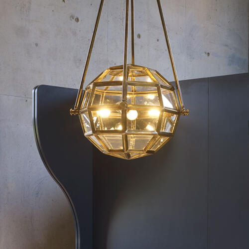 Icons Ceiling Lights by Collier Webb- a hanging globe light in brass