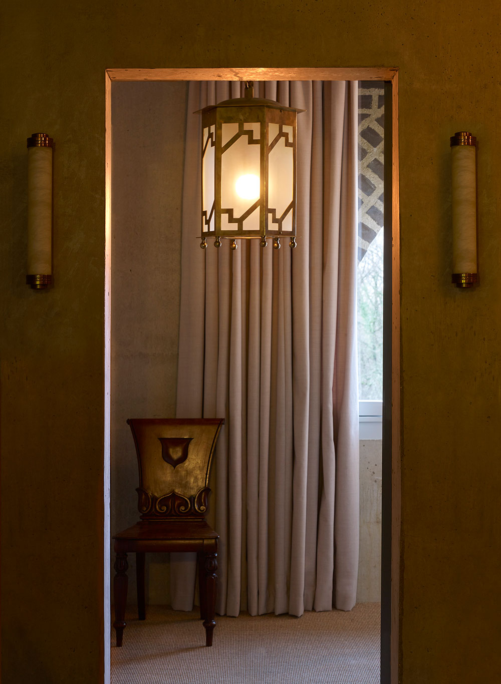a large frosted glass and brass lantern