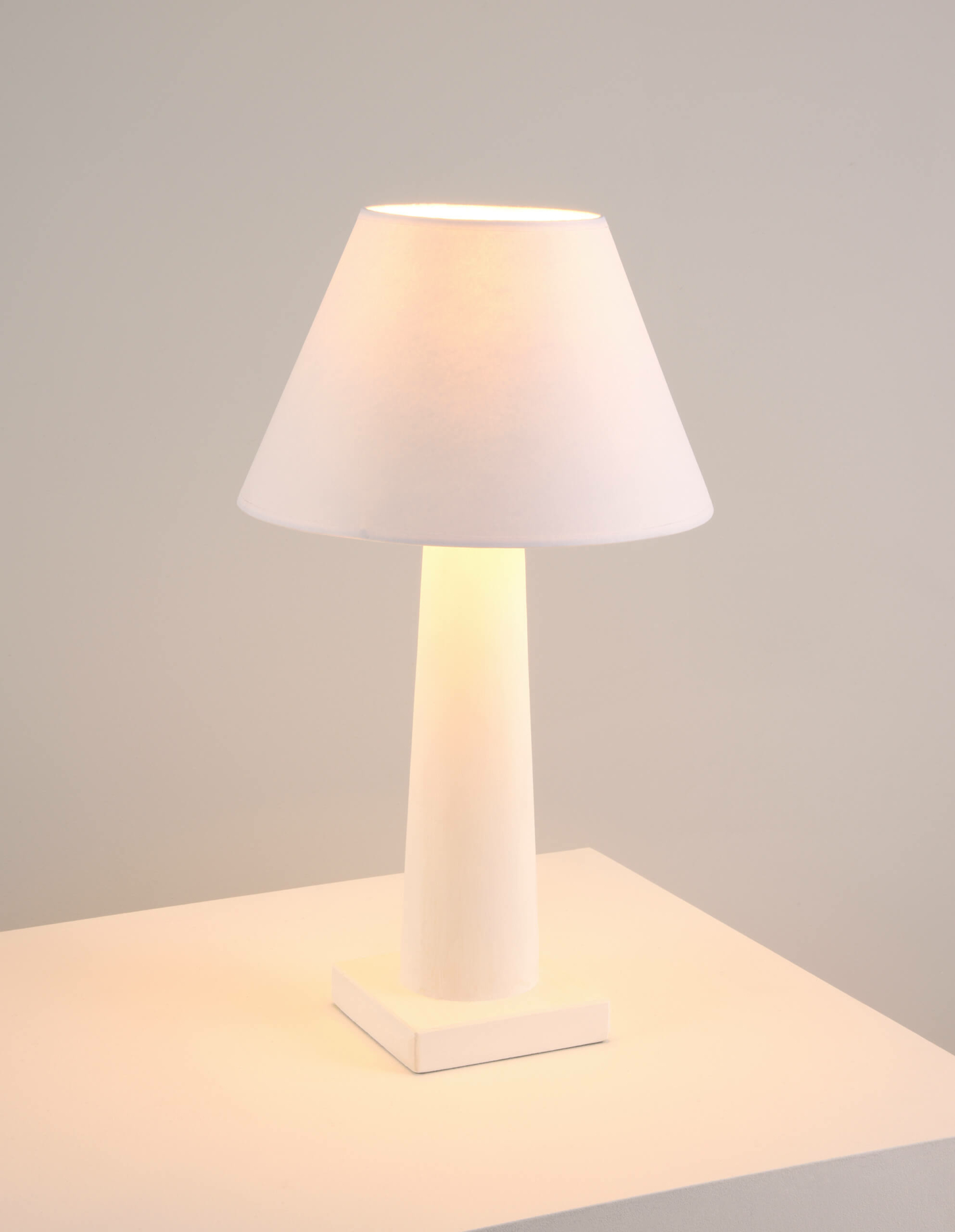 Frank Small - a plaster table lamp in white by Collier Webb