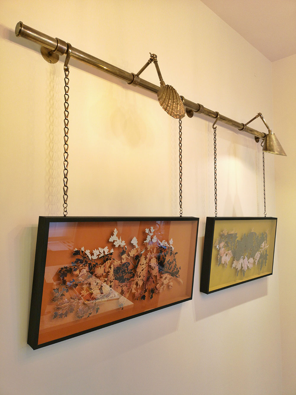 """Our brass rail, chain and lighting combined with pieces from the """"Flora Chimera"""" series"""